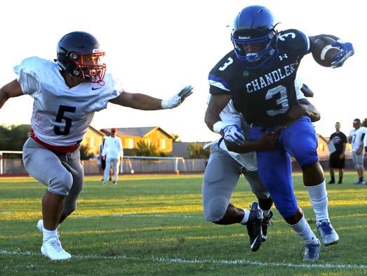Chandler's Tre Hart (3) runs the ball down the sideline