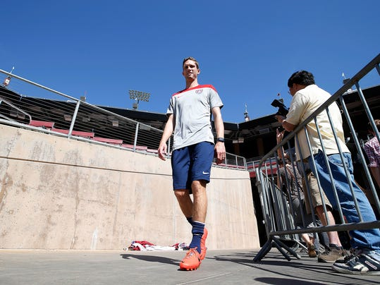 Clarence Goodson, of the US Men's National soccer team walks out onto the field during a training session on Wednesday, May 14, 2014, Stanford, Calif.  The US national soccer team kicked off its preparation camp at Stanford University preparing for the World Cup tournament, which gets underway in June. (AP Photo/Tony Avelar)