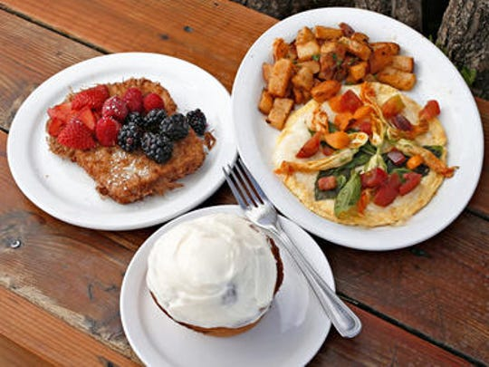 Clockwise from upper left seasonal french toast, a squash blossom omelette, and a cinnamon roll