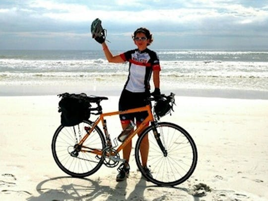 Cyclist Patricia Waiwood at the end of a ride she made from Ohio to Elgin Air Force base in Florida.
