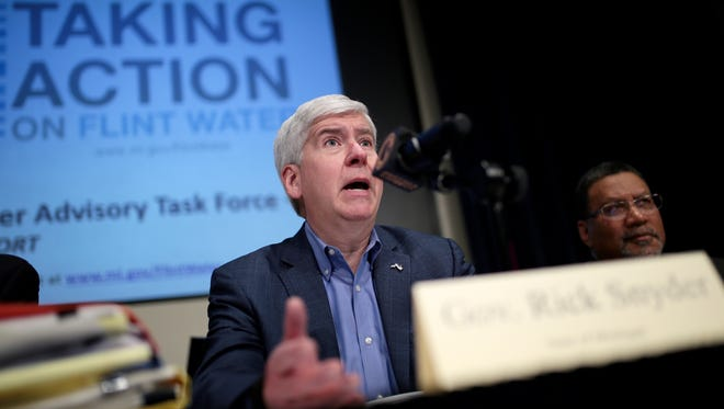 Gov. Rick Snyder, who appointed the task force in October, joined task force members at Mott Community College in Flint on Wednesday morning for the report's release.