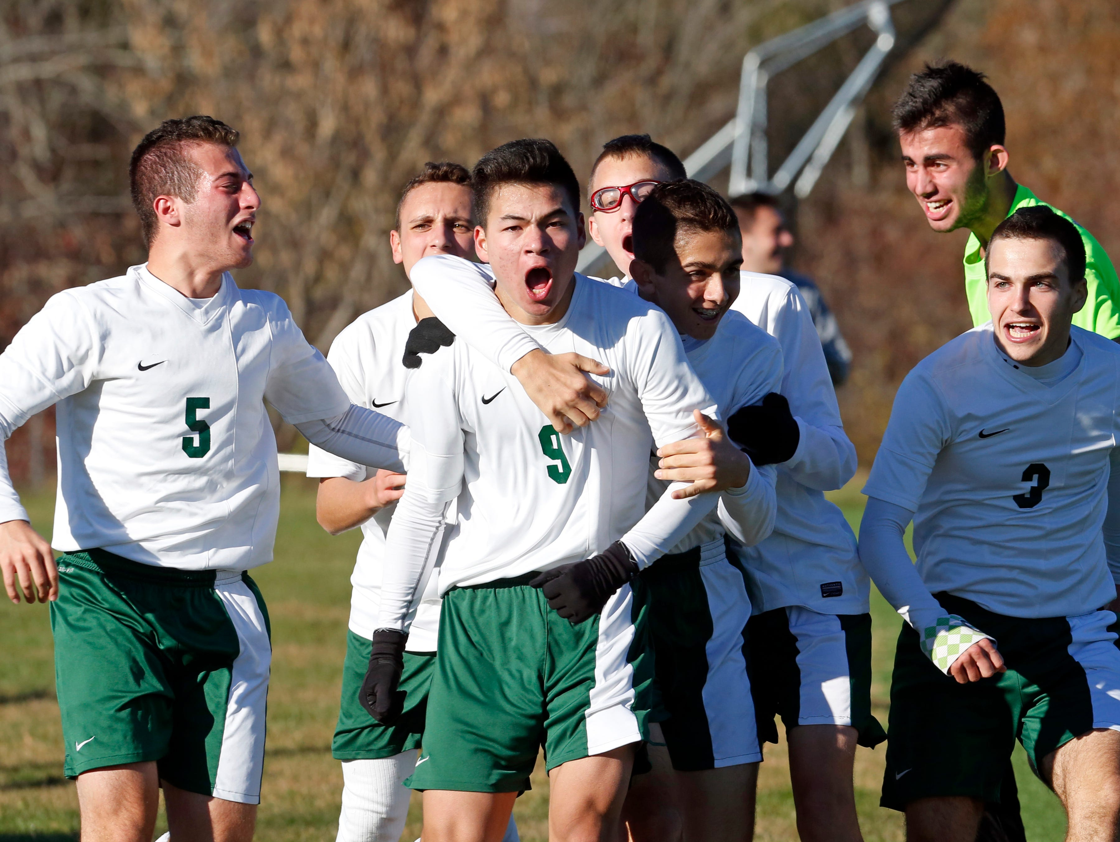Solomon Schechter celebrates their 2-1 victory in the Class C boys soccer final after Miles Ogihara, center, scored the winning goal in overtime against Hamilton, Oct. 30, 2015 at Arlington High School in Lagrangeville.