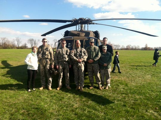 On Nov. 13, a Black Hawk helicopter landed at Copper Hill School for a Veterans Day visit. Pilot Mike Polyak, who is the father of a Copper Hill student, was joined by a team for the copter's landing, visit, take-off and a final fly-by. The students had the opportunity to climb aboard, check out the equipment and wave and cheer as the copter landed and took off again. Special thanks to the New Jersey Army National Guard UH60 Crew: CW4 Michael Polyak, 1LT Brent Long, SGT Ralph Foy; and passengers Msgt Matthew Polyak USAF, and SSgt Katie Williams, USAF.