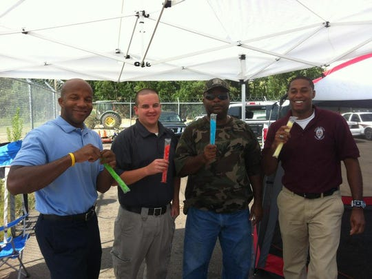 Sgt. Eddie Smith (second from right) eating popsicles