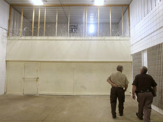 The Henry County Jail had two inmates escape early Monday morning through a hole they in the upper level of the side of the building. They were captured and back in the facility by early that afternoon. The hole the inmates escaped through is seen in the upper middle.