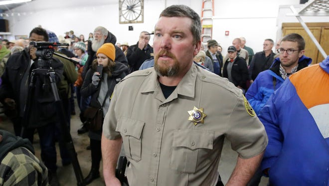 In this Jan. 6, 2016 file photo, Harney County Sheriff David Ward arrives at a community meeting at the Harney County fairgrounds in Burns, Ore.