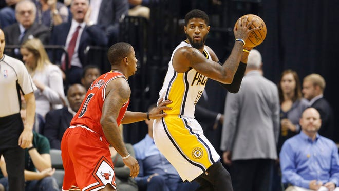 Nov 5, 2016; Indianapolis, IN, USA; Indiana Pacers forward Paul George (13) is guarded by Chicago Bulls guard Isaiah Canaan (0) at Bankers Life Fieldhouse.