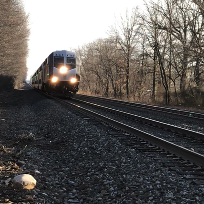 A Bergen line NJ Transit train roars through a Glen