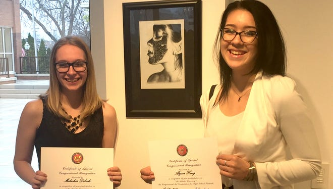 Alyssa Hang and Malachia Dabeck have been named winners of the recent Wisconsin Congressional Art Competition in Fond du Lac. Out of 33 works representing high schools within Congressman Glenn Grossman's district, Hang took first and will visit Washington D.C. to see her work at the opening of the national exhibit in June. Her artwork will hang in the halls of Congress until 2017. Her prize included the trip with one parent. Dabeck was second and too will have her work displayed until 2017.
