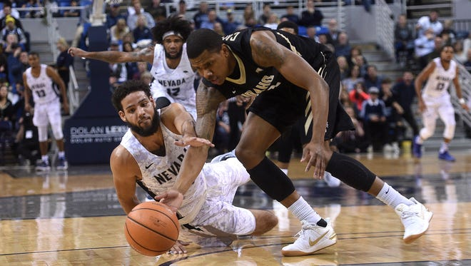 Nevada's Caleb Martin (10) battles for a loose ball while taking on Idaho during their basketball game at Lawlor Events Center on Friday.
