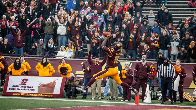 Central Michigan wide receiver Deon Butler (15  scores the first touchdown for his team during the first half of an NCAA college football game against Western Michigan, Saturday, Nov. 22, 2014, in Mt. Pleasant, Mich.