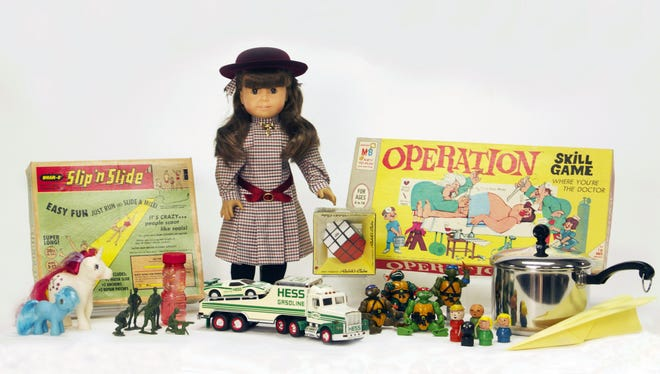 This photo provided by the National Toy Hall of Fame shows the 12 finalists for induction into the 2014 National Toy Hall of Fame. The nominees are Fisher-Price Little People, Hess toy trucks, My Little Pony, Rubik's Cube, Slip 'N Slide, Teenage Mutant Ninja Turtle Toys, American Girl dolls, the game Operation, little green Army men and bubbles, and pots and pans and paper airplanes. Two winners will be inducted on Nov. 6.