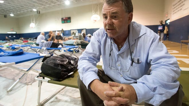 Waterfront Mission refugee Dwight Perdew takes temporary shelter with others men from the mission at the Salvation Army Wednesday afternoon.