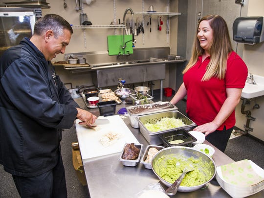 Baja Fresh executive chef Francisco Castellanos, left, talks with Baja Fresh franchisee Kelly Smith in the Kahala Test Kitchen in Scottsdale, Wednesday, July 11, 2018.
