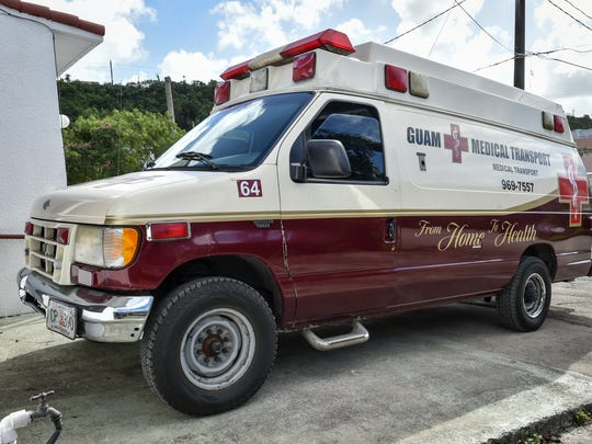 Medical transport trucks park outside the Guam Medical Transport office in Tamuning are shown in this file photo.
