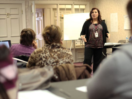 Najwa Dahdah from Shelby Township teaches a class about running day care facilities to immigrant women on Tuesday at the ACCESS Social Services Agency in Sterling Heights.