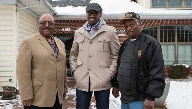 From left, Gilbert Cephas, Dion Banks, and William Jackson pose for photo in front of the Cambridge Empowerment Center on Tuesday, Jan. 10, 2017.