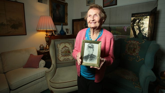 Palm Desert resident Helen Loring Ensign, 86, holds a photograph Wednesday, Nov. 13, 2014 of Civil War officer First Lt. Alonzo H. Cushing, who is her first cousin, twice removed. On Nov. 6, Cushing was presented the nation's highest military decoration for valor, the Medal of Honor. As Cushing's U.S. Army designated primary next of kin, Ensign accepted the medal on his behalf from President Barack Obama during a ceremony at the White House. Lt. Cushing was killed in action on the last day of the Battle of Gettysburg, July 3, 1863, at Cemetery Ridge as he and his men defended against the Confederate assault known as Pickett's Charge.