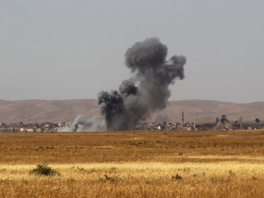 Smoke billows as Iraqi forces and fighters from the