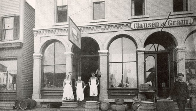 Clausen and Gram, pictured here circa 1871-77, was owned by Harold H. Clausen and Hans Gram and located on Wisconsin Avenue in Neenah. The store became Gram and Miller in 1878.