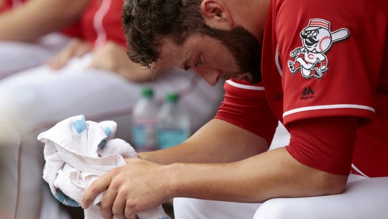 Reds starting pitcher Cody Reed hangs his head after