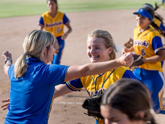 Exeter head coach Karen Zeibak, left, congratulates pitcher Brooklyn Blackmon after their win over Washington Union in a Central Section Division IV high school softball quarterfinal game on Friday, May 18, 2018.