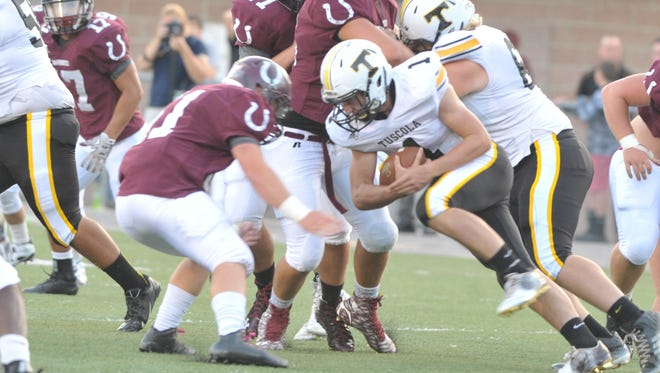 Caleb Ferguson (1) has rushed for more than 1,000 yards each of the past two seasons at Tuscola.
