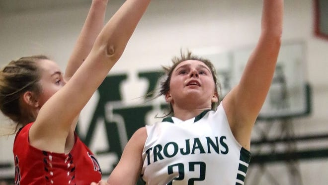 Wauwatosa West's Emily Wagy (22) attempts to shoot over East's Johanna Taylor (left) during a game at Wauwatosa West on Jan. 7.