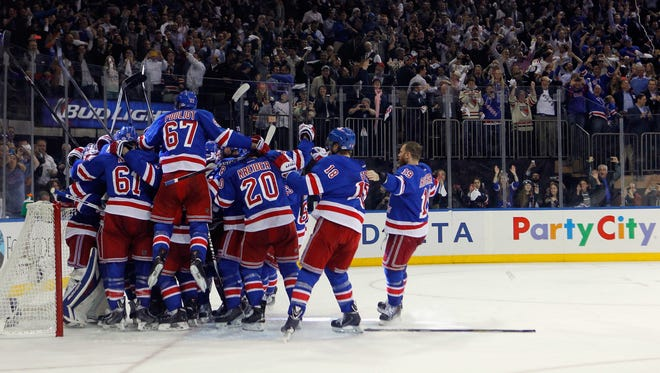 The New York Rangers celebrate after defeating the Montreal Canadiens in the Eastern Conference Final.