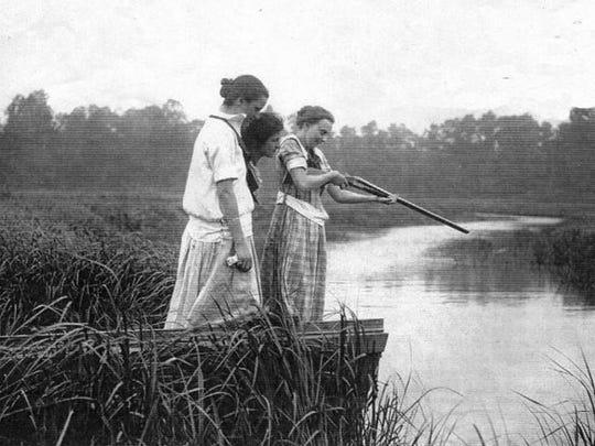 Local residents scan the water with a shotgun at Matawan Creek following the 1916 shark attacks.