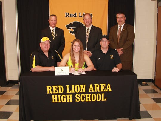 Sierra Donovan signs to play college lacrosse at West Virginia Wesleyan.Head Coach Steve Unger and assistant Dan Godfrey surrounded her. Back Row: Arnie Fritzius, Director of Athletics;  Dr. Scott Deisley, Superintendent;   Mark Shue, Principal