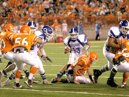 Carlsbad's Jacob Galindo spots an open gap on Sept. 26, 2008 at Artesia. Artesia won that game, 28-24, and has won nine of the past 11 meetings overall.
