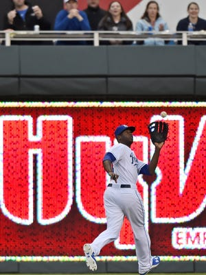 Kansas City Royals center fielder Lorenzo Cain (6) runs back to make a catch.