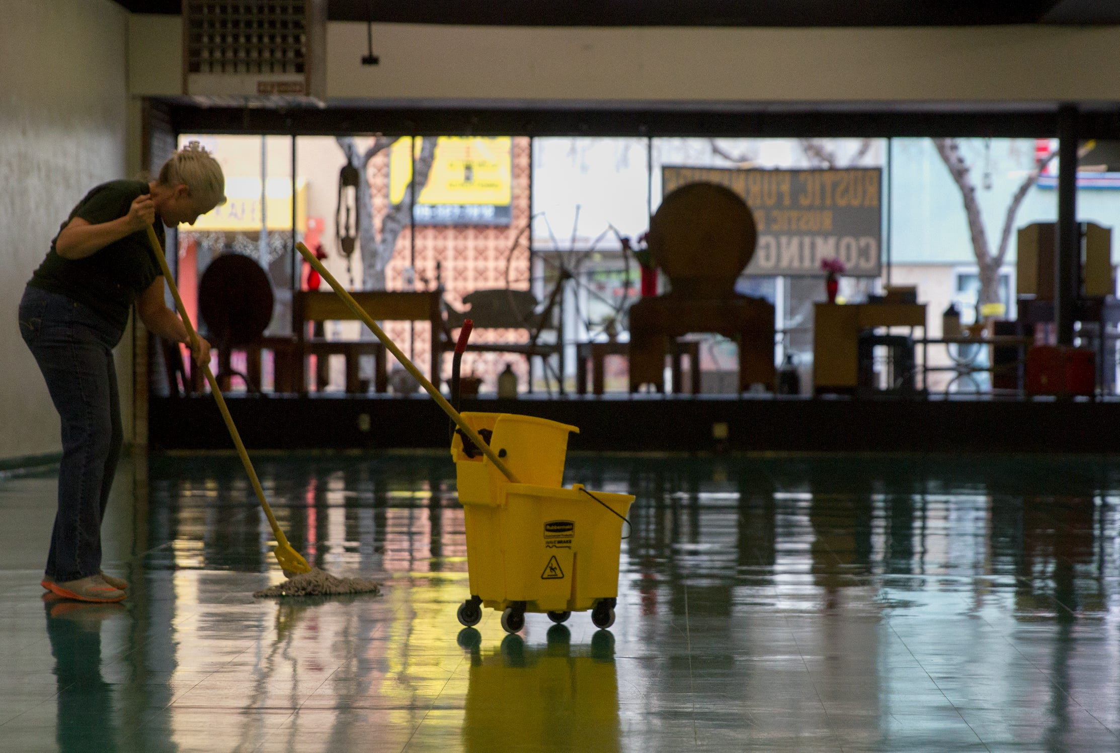 Vickie DeFelice Cleans The Floor On Monday At A Rustic