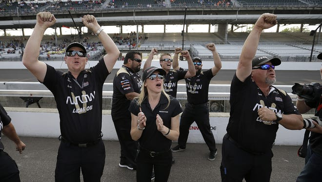 James Hinchcliffe's crew celebrates the Canadian's qualifying run.