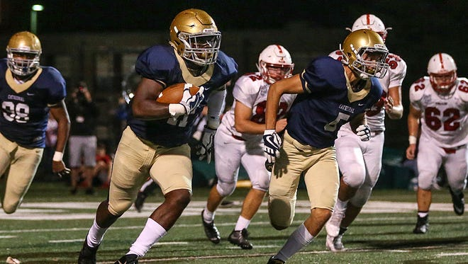 Cathedral Fighting Irish inside linebacker Hugh Davis (11) recovers a Center Grove Trojans fumble to run a 96-yard touchdown during second half action between Cathedral and Center Grove at Arsenal Technical High School, Indianapolis, Friday, Oct. 13, 2017. Cathedral won, 21-14.