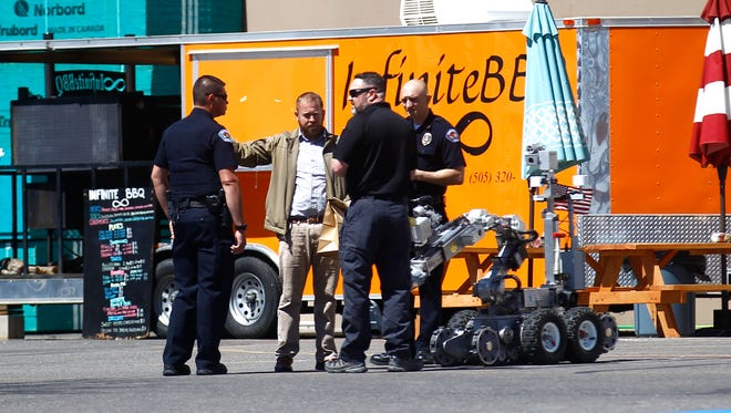 Farmington police officers investigate a suspicious package on Monday at Lowe's Home Improvement in Farmington.