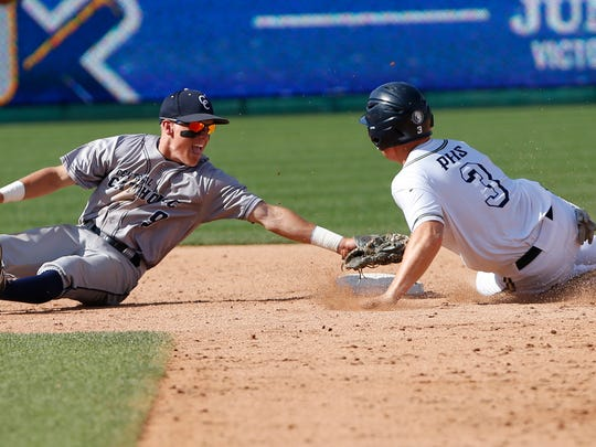 Central Catholic shortstop Tyler Powers lunges to tag