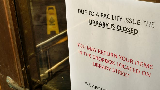A sign on the door of the Skillman Branch of the Detroit Public Library states the branch is closed on Thursday, February 1, 2018, in downtown Detroit. A burst pipe caused water damage at the library branch.
