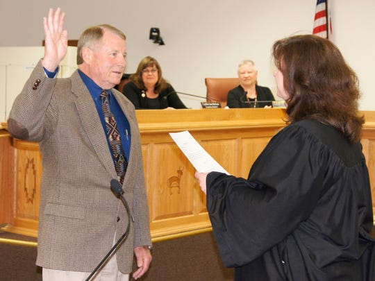 Silver City's new Mayor Ken Ladner was sworn into office by Magistrate Judge Maurine Laney on Monday at the Grant County Administration Building. Also sworn in were Councilors Lynda Aiman-Smith and Guadalupe Cano. The Town Council will hold it's first meeting under the direction of Mayor Ladner at 6 p.m. tonight at the Grant County Administration Building. For more photos, visit facebook.com/scsunnews.