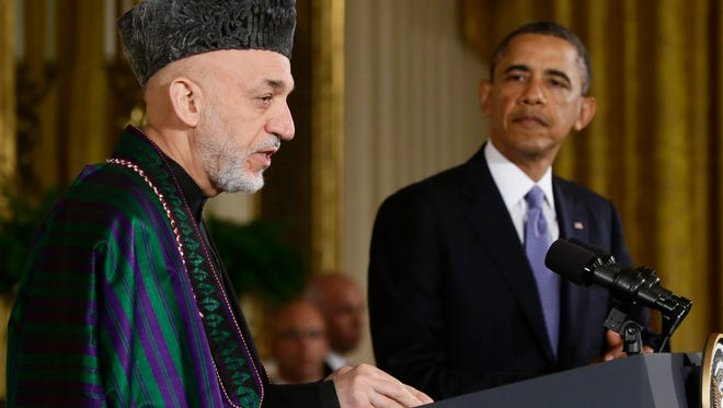 President Obama and Afghanistan President Hamid Karzai, earlier this year.