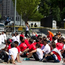 Demonstrators are arrested outside the White House in Washington on Thursday, Aug. 28, 2014 during a rally calling for President Barack Obama to stop deportations of migrants in the country illegally and to make a decision on how to provide relief for immigrant families. U.S. Park Police said 145 people were arrested.