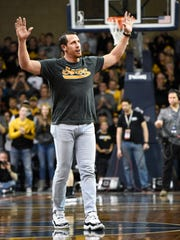 South Dakota native and former Minnesota Vikings linebacker Chad Greenway waves to the crowd before the first half of the Iowa vs. Colorado game at the Sanford Pentagon on Dec. 22, 2017 in Sioux Falls, S.D.