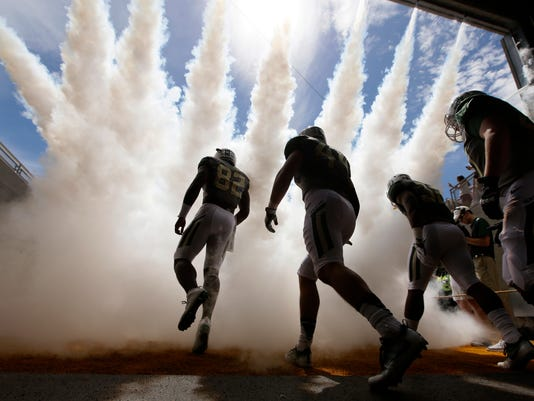 FILE - In this Saturday, Sept. 10, 2016, file photo, Baylor defensive tackle Micheal Johnson, left, leads teammates onto the field before an NCAA college football game against SMU in Waco, Texas. Defensive-minded West Virginia and Baylor will try this week to remain the Big 12's only undefeated teams. (AP Photo/LM Otero, File)