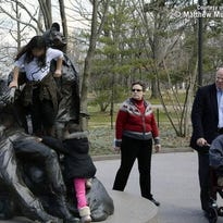 Children climb the Vietnam Women's Memorial in Washington, D.C., in March.