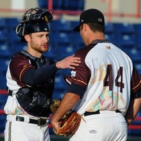 Jonathan Lucroy of the Milwaukee Brewers, on rehab assignment with the Brevard County Manatees, talks with starting pitcher Javier Salas during Thursday's game in Viera, Fla.