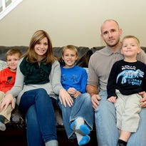 Annie Scholten is shown in December with her husband, Darrell, and their three boys,  Lucas (from left),  Eli and Logan in December at their Williamston home. Annie Scholten died late Wednesday at age 31.