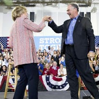 Hillary Clinton fist-bumps Sen. Tim Kaine, D-Va., after speaking at a rally in Annandale, Va., on July 14, 2016
