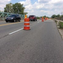 Vehicles negotiate lane closures on the Marsh Road bridge in 2015. This year the bridge is undergoing a $1.6 million superstructure replacement.