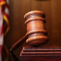 A Many woman faces an October sentencing date after she pleaded guilty Tuesday to having a shotgun with an illegal barrel, according to the U.S. Attorney's Office.